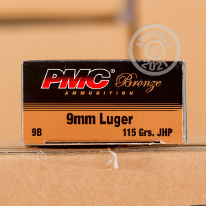 A photograph detailing the 9mm Luger ammo with JHP bullets made by PMC.