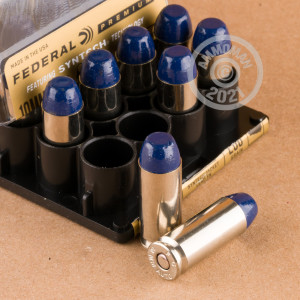 Image of 10mm ammo by Federal that's ideal for home protection, hunting wild pigs.
