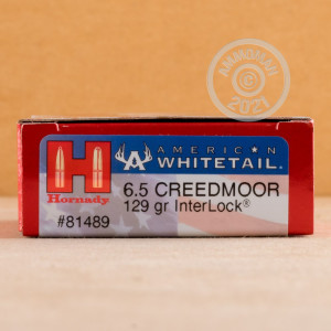 Photo detailing the 6.5MM CREEDMOOR HORNADY AMERICAN WHITETAIL 129 GRAIN INTERLOCK SOFT POINT (200 ROUNDS) for sale at AmmoMan.com.