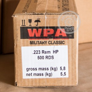 A photograph of 500 rounds of 55 grain 223 Remington ammo with a HP bullet for sale.