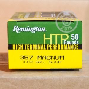 A photograph detailing the 357 Magnum ammo with semi-jacketed hollow-Point (SJHP) bullets made by Remington.