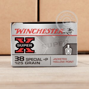 A photograph detailing the 38 Special ammo with JHP bullets made by Winchester.