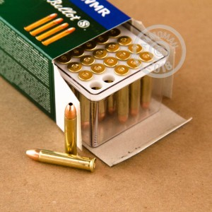 Photograph of .22 WMR ammo with JHP ideal for hunting varmint sized game, training at the range.