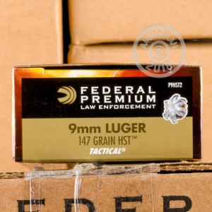 A photograph of 1000 rounds of 147 grain 9mm Luger ammo with a JHP bullet for sale.