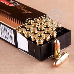 Photo of 9mm Luger FMJ ammo by PMC for sale at AmmoMan.com.