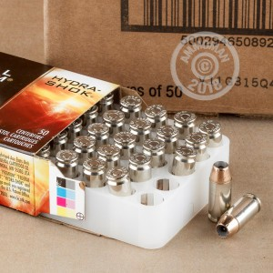 A photograph of 50 rounds of 155 grain .40 Smith & Wesson ammo with a JHP bullet for sale.