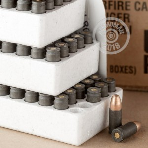 A photograph detailing the bulk 9mm Luger ammo with FMJ bullets made by Winchester and commonly used for training at the range.