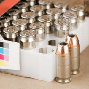 A photograph of 20 rounds of 230 grain .45 Automatic ammo with a JHP bullet for sale.