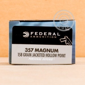 A photograph of 500 rounds of 158 grain 357 Magnum ammo with a JHP bullet for sale.
