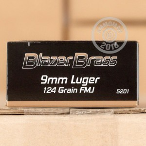 A photograph detailing the 9mm Luger ammo with FMJ bullets made by Blazer Brass.
