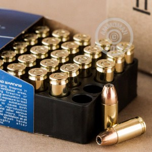 A photograph of 50 rounds of 115 grain 9mm Luger ammo with a JHP bullet for sale.