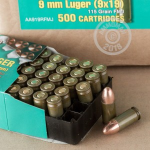 A photograph detailing the 9mm Luger ammo with FMJ bullets made by Brown Bear.
