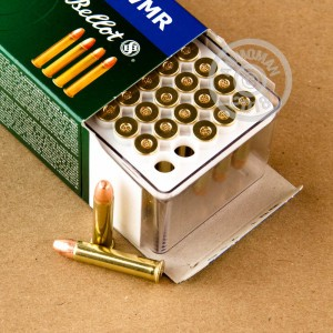 rounds of .22 WMR ammo with copper plated round nose bullets made by Sellier & Bellot.