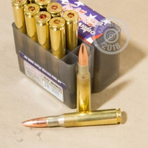 A photograph of 10 rounds of 647 grain .50 BMG ammo with a TSX bullet for sale.