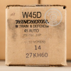 A photograph detailing the .45 Automatic ammo with JHP bullets made by Winchester.