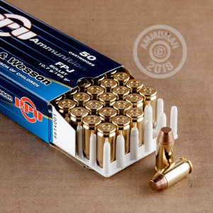 A photograph of 500 rounds of 165 grain .40 Smith & Wesson ammo with a FMJ bullet for sale.