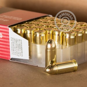 A photograph of 50 rounds of 73 grain .32 ACP ammo with a FMJ bullet for sale.
