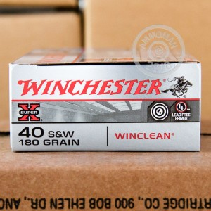 A photograph of 500 rounds of 180 grain .40 Smith & Wesson ammo with a brass enclosed base bullet for sale.