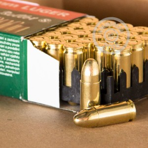A photograph of 500 rounds of 115 grain 9mm Luger ammo with a FMJ bullet for sale.