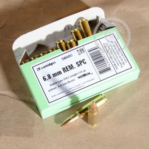A photograph detailing the 6.8 SPC ammo with FMJ bullets made by Sellier & Bellot.