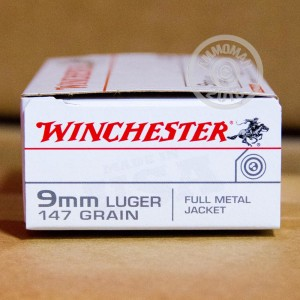 A photograph of 50 rounds of 147 grain 9mm Luger ammo with a full metal jacket flat-point bullet for sale.