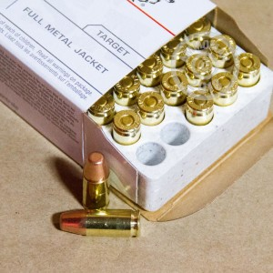 A photograph detailing the 9mm Luger ammo with full metal jacket flat-point bullets made by Winchester.