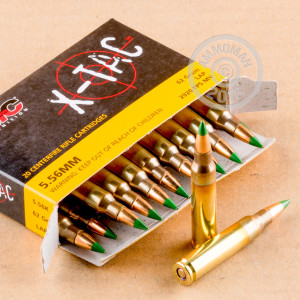 A photograph of 20 rounds of 62 grain 5.56x45mm ammo with a FMJ bullet for sale.