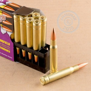 A photograph detailing the 30.06 Springfield ammo with FMJ bullets made by Golden Bear.