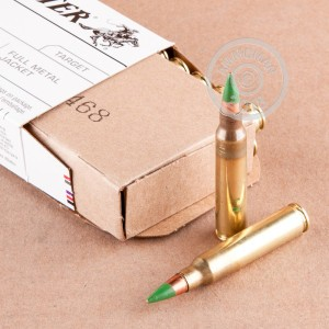 A photograph of 1000 rounds of 62 grain 5.56x45mm ammo with a FMJ bullet for sale.
