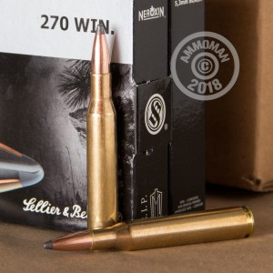 A photograph of 20 rounds of 130 grain 270 Winchester ammo with a Nosler Partition bullet for sale.