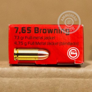A photograph of 1000 rounds of 73 grain .32 ACP ammo with a FMJ bullet for sale.