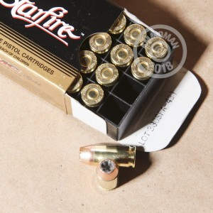 A photograph detailing the .380 Auto ammo with JHP bullets made by PMC.