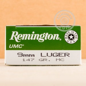 A photograph detailing the 9mm Luger ammo with FMJ bullets made by Remington.