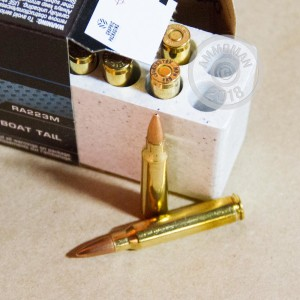 A photograph detailing the 223 Remington ammo with Hollow-Point Boat Tail (HP-BT) bullets made by Winchester.