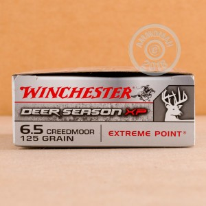 A photograph detailing the 6.5MM CREEDMOOR ammo with Polymer Tipped bullets made by Winchester.