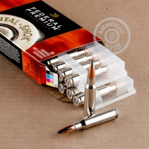 A photograph of 20 rounds of 180 grain 308 / 7.62x51 ammo with a Nosler Partition bullet for sale.