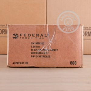 A photograph detailing the 5.56x45mm ammo with FMJ bullets made by Federal.