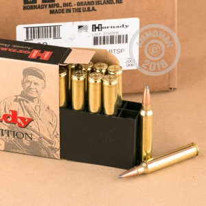 A photograph of 20 rounds of 165 grain 300 Winchester Magnum ammo with a Soft-Point Boat Tail (SP-BT) bullet for sale.