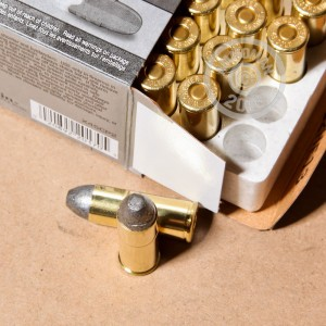 A photograph detailing the .45 COLT ammo with Lead Round Nose (LRN) bullets made by Winchester.