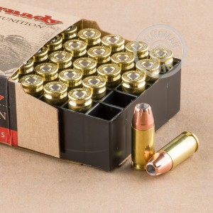 A photograph detailing the 9mm Luger ammo with JHP bullets made by Hornady.