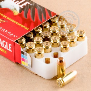 A photograph detailing the .40 Smith & Wesson ammo with FMJ bullets made by Federal.