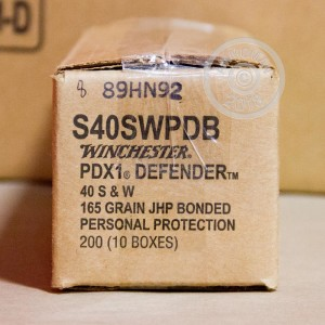 A photograph of 20 rounds of 165 grain .40 Smith & Wesson ammo with a JHP bullet for sale.