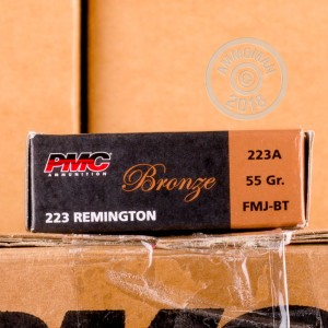 A photograph detailing the 223 Remington ammo with FMJ-BT bullets made by PMC.