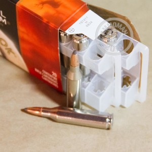A photograph detailing the 243 Winchester ammo with Soft-Point Boat Tail (SP-BT) bullets made by Federal.