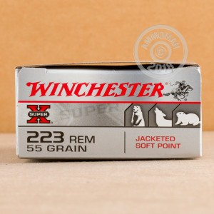 A photograph of 200 rounds of 55 grain 223 Remington ammo with a Jacketed Soft-Point (JSP) bullet for sale.