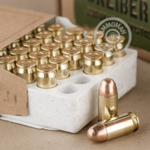 A photograph detailing the .45 Automatic ammo with FMJ bullets made by Winchester.