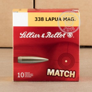 A photograph of 10 rounds of 250 grain 338 Lapua Magnum ammo with a Hollow-Point Boat Tail (HP-BT) bullet for sale.