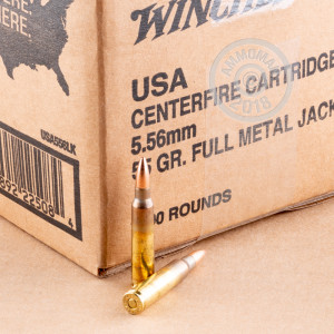 A photograph detailing the 5.56x45mm ammo with FMJ bullets made by Winchester.