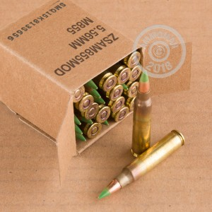 A photograph of 1800 rounds of 62 grain 5.56x45mm ammo with a FMJ bullet for sale.