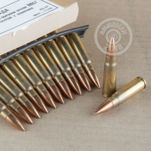 Image detailing the brass case and berdan primers on 1120 rounds of Military Surplus ammunition.